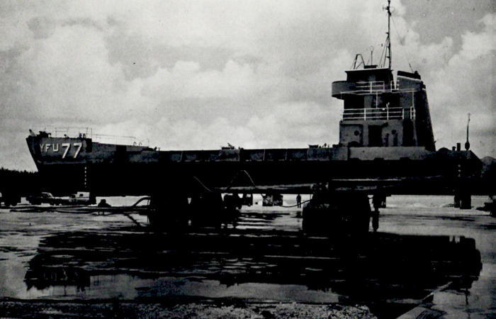 Air Caster Transporters being used to support and carry a navy ship across dry land.